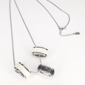 Guess Necklace 3 Ring Pendants on Silver Chain